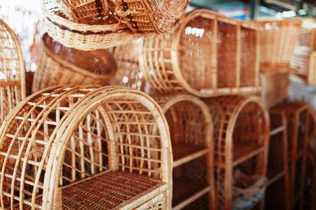 Handmade wicker furniture, products and souvenirs at the street craft market. Wicker baskets in a street market