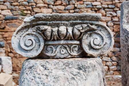 Beautiful ruins of urban architecture, graceful decoration of buildings. Parts of the ruins and ruins of ancient antiquity. City of Ephesus, Turkey