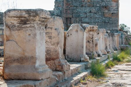 Columns of elements of buildings, parts of the ruins and antiquity of the ancient. City of Hierapolis, Turkey