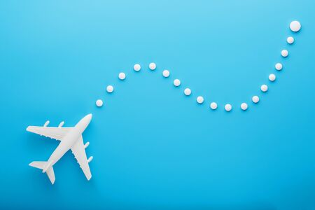 White model of a passenger plane with dotted trajectory points isolated on background. The route of the aircraft in the countries and the sky. Conceptual graphic element for air travel presentation.
