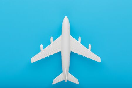 Passenger Model airplane on a blue background. Free space for text. Concept for travel and airlines. Фото со стока