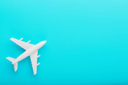 White passenger plane on a blue background. 版權商用圖片