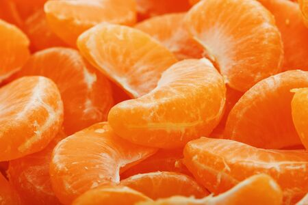 Lots of slices of juicy tangerines as background texture. Useful fruit on the whole screen. Stock fotó