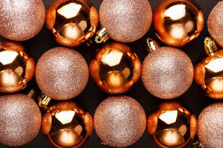 Golden Christmas balls close up as background. Full screen, New year and Christmas concert Stock Photo