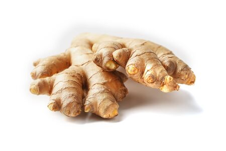 Fresh ginger root on a white background, isolate close-up. Ginger pharmacy. Banco de Imagens