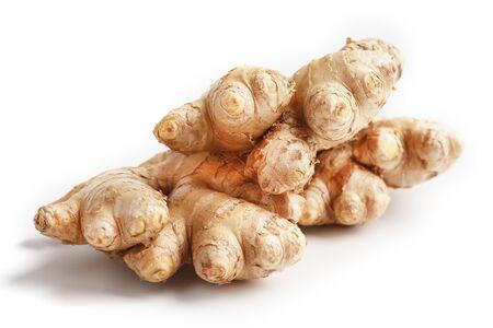 Fresh ginger root on a white background, isolate close-up. Ginger pharmacy. 版權商用圖片