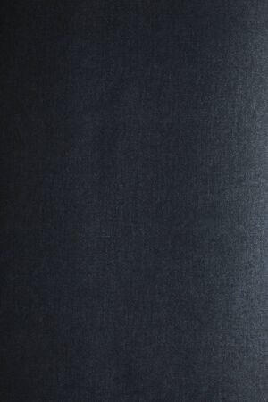 The texture of a black blank page tablet for pastels. Black background of paper texture. As a background for text 版權商用圖片