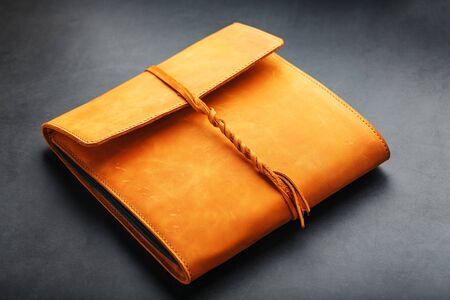 Photo album with blank black for photos. Split rings for close-up macro albums.The album cover is made of brown handmade genuine leather on a black background. Free space for text and photos
