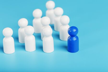 The leader in blue leads a group of white employees to victory, HR, Staff recruitment. The concept of leadership. A lot of employees are reaching for their boss. Personnel selection.
