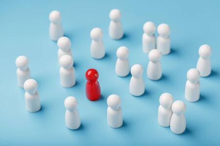 The leader of the red color stands among the crowd, a group of white employees. The concept of leadership. Many employees are drawn to their boss. Personnel selection. How to choose a leader from a crowd of employees.