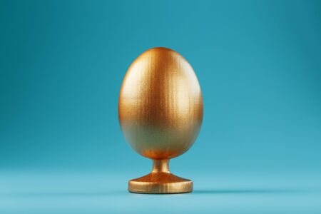 Golden egg on a blue background with a minimalistic concept. Space for text. Easter egg design templates. Stylish decor with minimal concept. Copy space, holiday flat layout of the card