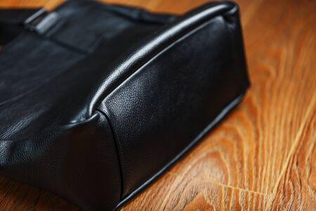 Women's black leather handbag isolated on white background Stockfoto