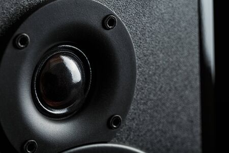 Multimedia speaker system speaker close-up on a black background. A detailed snapshot of some of the old round speakers. Powerful and clear sound