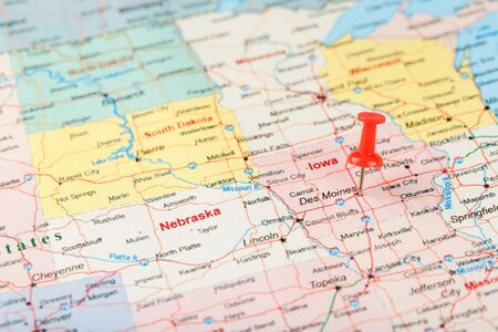 Red clerical needle on a map of USA, Iowa and the capital Des Moines. Close up map of Iowa with red tack, United States map pin USA