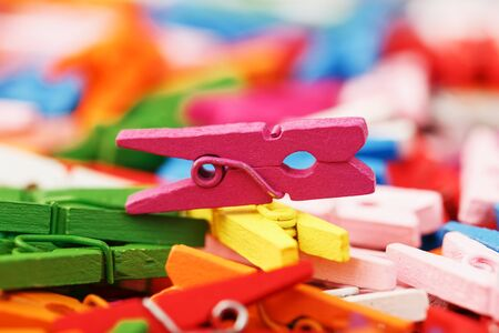 Colorful Wooden clothespins close-up as texture and background. Decorative clothespins for creativity and needlework. 版權商用圖片