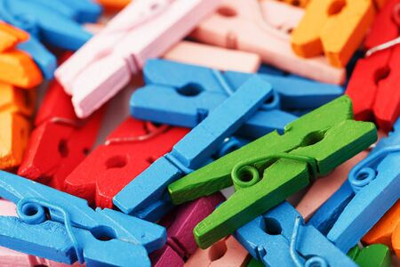 Colorful Wooden clothespins close-up as texture and background. Decorative clothespins for creativity and needlework.
