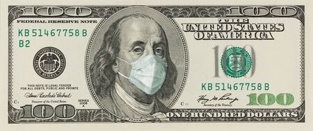 A 100-dollar bill with a face mask by Benjamin Franklin from the COVID-19 Coronavirus in the United States. The COVID virus outbreak is affecting the global stock market and economy. The concept of the Financial crisis and pandemics.