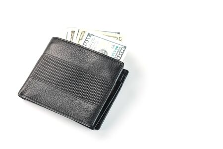 Black wallet with genuine leather dollars on an isolated white background. A symbol of prosperity and prosperity.