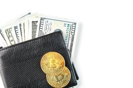 A black wallet with dollars and bitcoins on an isolated white background. Symbol of prosperity and prosperity. Free space