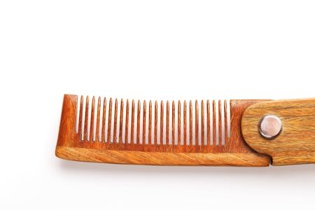 Wooden comb made of natural sandalwood for men on a white background. Care for men's hair and beard. Isolate. Barbershop