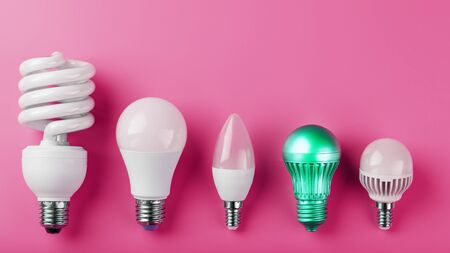 A special Light bulb stands out from the group of ordinary white light bulbs on a pink background. Minimalistic style with conceptual ideas. Be different