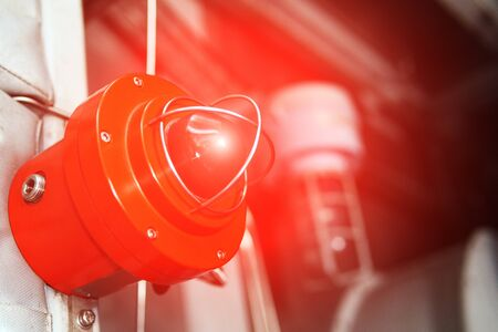 Fire alarm with red warning light of an emergency beacon at an industrial facility. Danger signal Foto de archivo