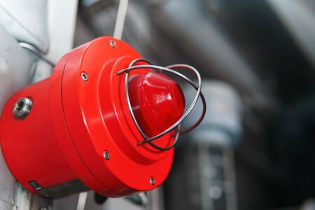 Red warning light of a fire system at an industrial facility. Light indication of danger.