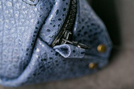 Zipper slider for a blue textured leather bag. Handmade. Close up