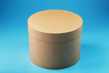 Round cardboard box on a blue background, free space. Online stores and Express delivery