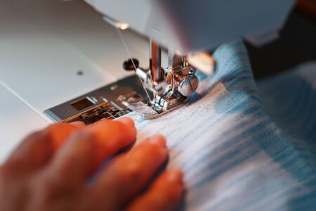Sewing clothes on a sewing machine close-up. Handmade at home Standard-Bild