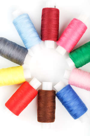 Colorful cotton craft sewing threads in flower shape isolated on white background. Free space, isolate close-up