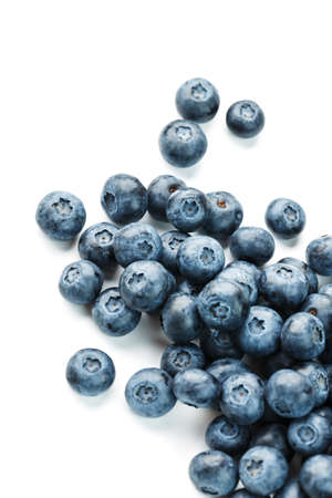Blueberries isolated on a white background. A scattering of ripe, juicy, delicious and healthy berries.