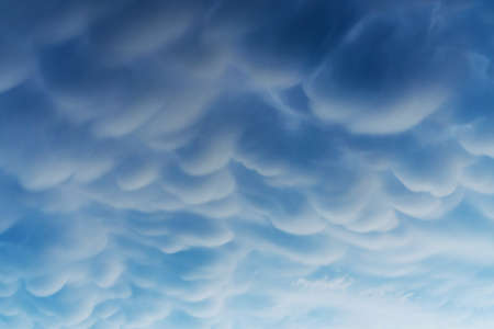 Blue Cumulus clouds, a rare atmospheric phenomenon. Standard-Bild