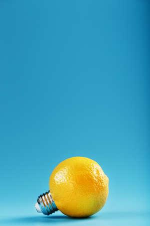 The light bulb is like a lemon on a blue background.