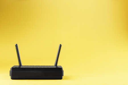 Router wireless LAN technology with devices based on IEEE 802.11 standards on a yellow background free space top view. Isolate