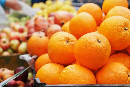 Oranges in the market close-up on the market counter. Eco farmer's fruit Archivio Fotografico