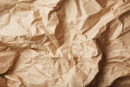 Craft crumpled paper as a texture background. full screen