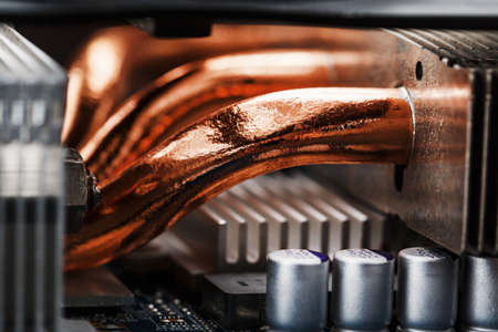 Video card cooling system with copper pipes, aluminum radiators and fans. Video chip for gaming and cryptocurrency mining. Dark key