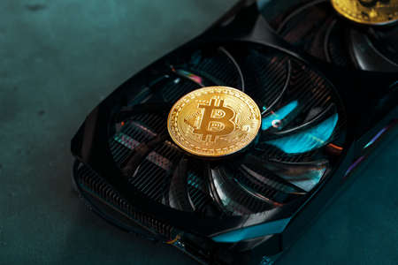 On the powerful fans of the video card there are coins of the Bitcoin cryptocurrency with a green backlight.