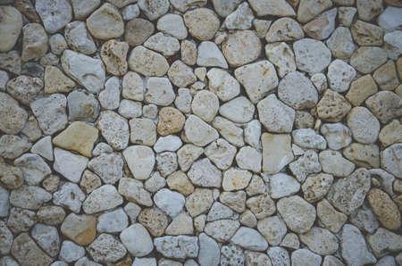каменные стены абстрактный фон с жестокими камнями Фото со стока