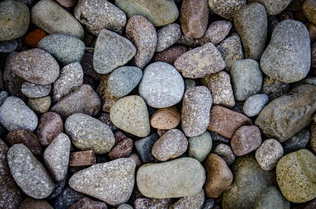 abstract background with dry rounded stones on the beach