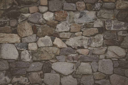 stone wall abstract background with brutal stones Stock Photo