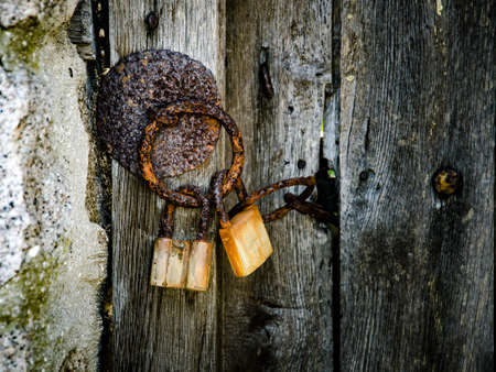 part of old wooden door with rusted iron ring Stock Photo