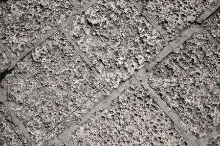 абстрактный фон с грубыми каменными плитками на тротуаре
