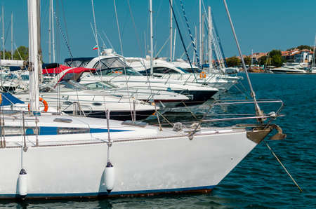 many beautiful moored saiboats in the sea port Stock Photo
