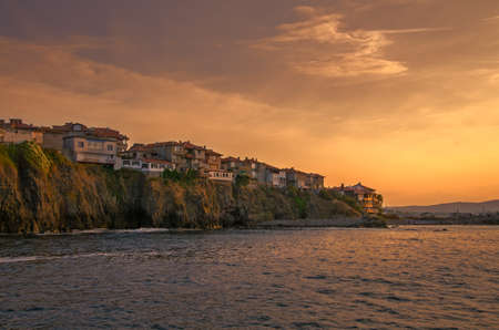panoramic evening view of a small town on rock cliff at sunset in sozopol, bulgaria Stock Photo