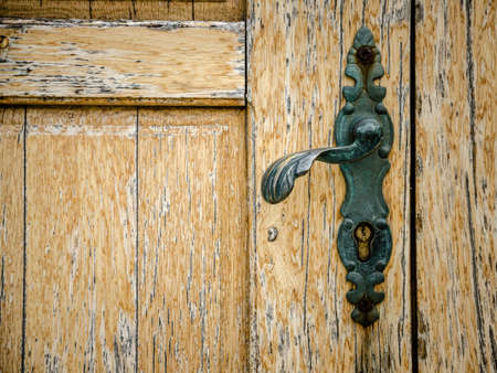 part of old wooden door with door knob Stock Photo