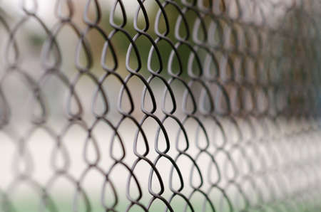 chain link fence with blurred background and foreground Stock Photo