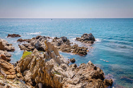 panoramic view of seashore with rock cliff in Costa Brava, Spain
