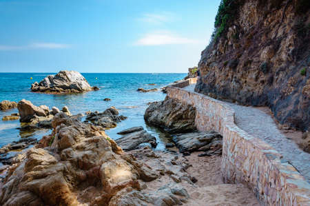 panoramic view of seashore with rock cliff and a road in Costa Brava, Spain
